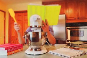 A kid's reading skills improve from from being in the kitchen. They learn different measurements, and to follow steps.