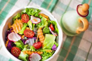 Eating a salad before your meal will help with digestion, and make you feel more full.