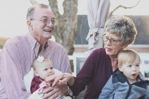 The benefits of being around your grandchildren include helping you feel younger, decrease stress, increase your lifespan, and make you happier overall.