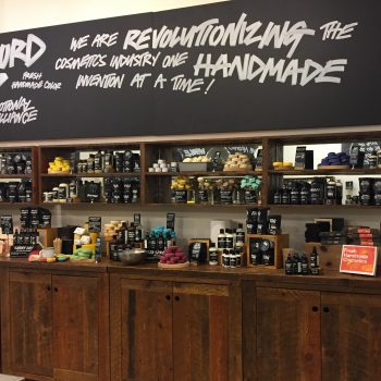 Lush products on a table and shelves.