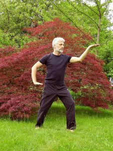Tai Chi is a chinese martial art kind of exercise. It is a low impact exercise that will  keep you moving while bringing relief on joint pain.