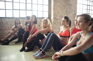 girls sitting in a yoga class