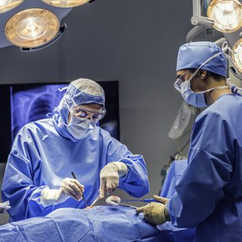 Doctors team in operating room emergency hernia surgery