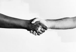 two people shaking hands in friendship