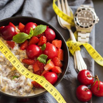 watch, oatmeal, and a tape measure fasting for weight loss