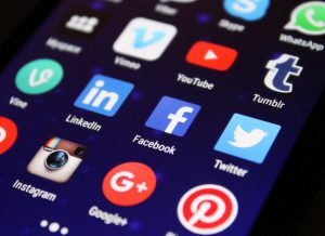 phone screen with social media marketing apps