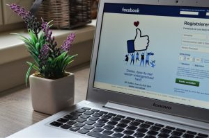 social media on a laptop showing business success