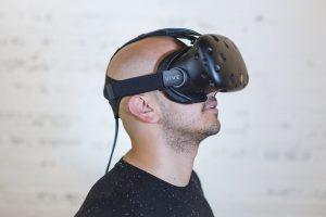 Caucasian man wearing a virtual reality headset.