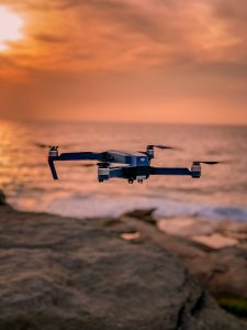 drone insurance for drone flying in the sunset