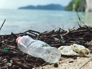 plastic bottles on a beach ruining the scene