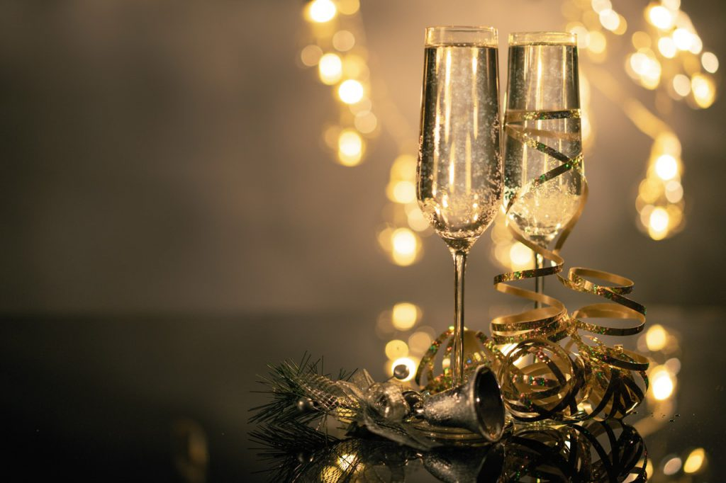 champagne glasses with holiday decor for surviving family stress