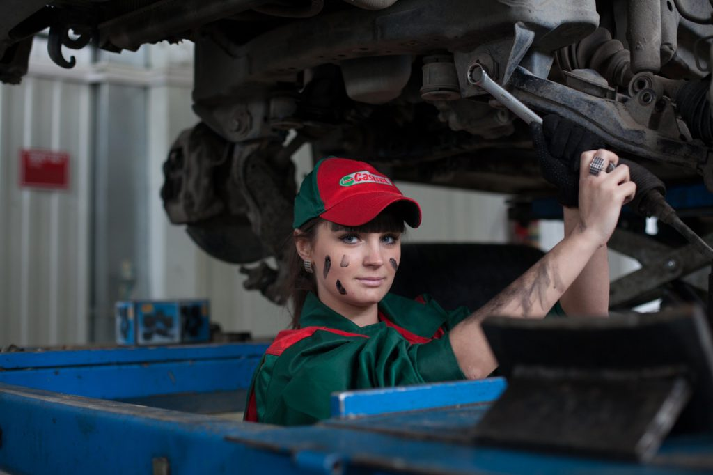 automotive worker fixing a car as employee