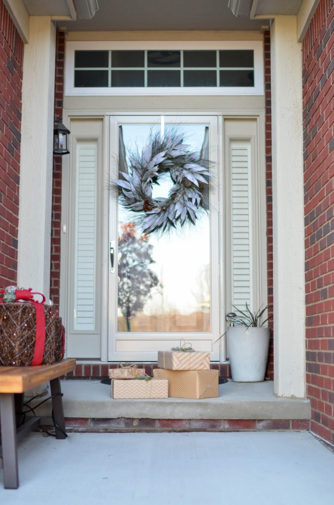 holiday wreath and presents outside a front door
