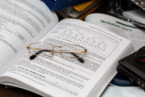 document with glasses for employer health