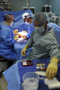 surgeons operating on someone who has worker's compensation to help