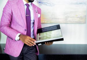 man in pink suit looking at insurance contact