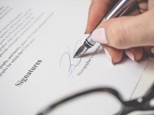 insurance contract with someone signing it