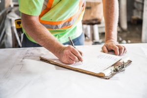 construction foreman with clipboard for risk management