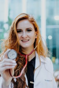 PCP holding red stethoscope