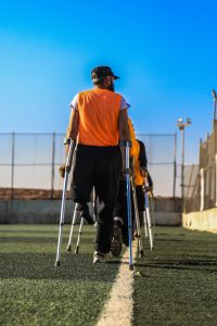 person with crutches covered by worker's compensation