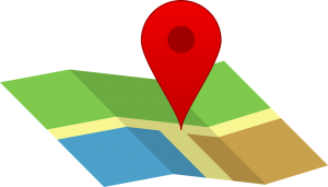 red location symbol over a colorful map