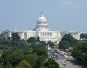 a picture of the outside of congress with trees around it.