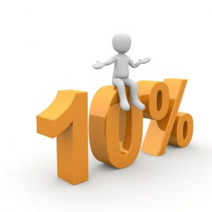 """figure sitting on top of """"10%"""" sign"""