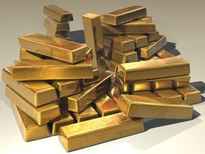 a pile of blocks of gold stacked on top of each other.