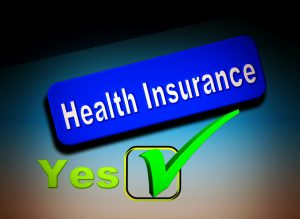 health insurance words in a blue box with a green check in a box next to a yes