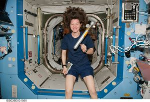 caucasian woman in space floating in a rocketship.