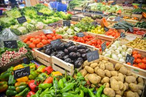 Market full of fresh produce of all different kinds.