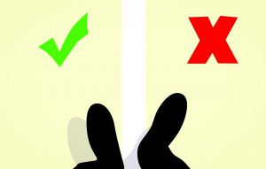 feet standing with a green check on the left and a red x on the right