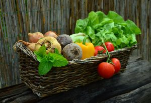 a variety of vegetables in a basket.