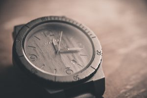 gray hand watch with the time 12:15 on it