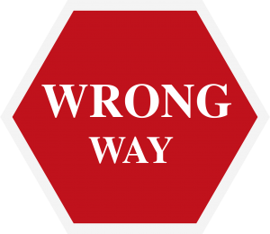 "red sign with the words ""wrong way"" on it in white."