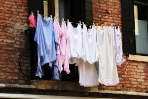 multiple laundry being hung outside.