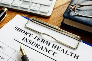 short-term health insurance form on a clipboard