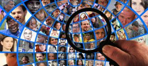 magnifying glass over a many clustered pictures of people