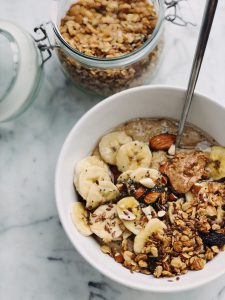 bowl filled with bananas, oats and nut butter.