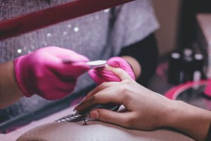 caucasian woman's hand getting a manicure