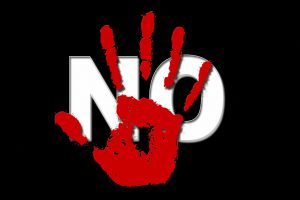 red hand over the word no in white