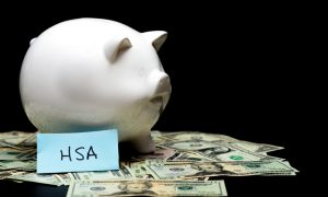white piggy bank with money around it and a paper that says HSA