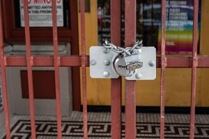 res gates locked with a padlock and chains