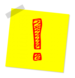 yellow post it not with a red exclamation point drawn on it