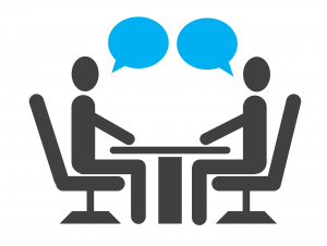 illustration of two people sitting at a table with two blue speech bubbles