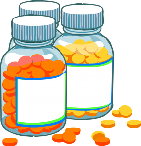 medication bottles with 2 different kinds of pills in each, one yellow and one orange.