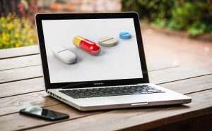 different types of pills on a laptop screen