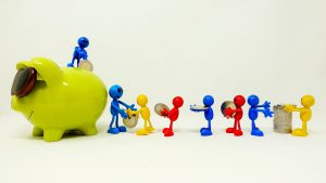 different people ficures carrying a coin to a piggy bank with someone standing on top grabbing the coin
