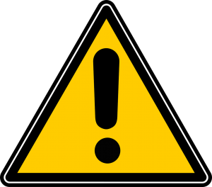 caution sign ; yellow triangle with black exclamation point in the middle