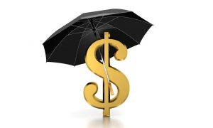 gold money sign with a black umbrella over it